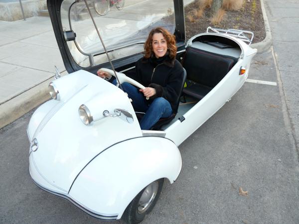 Photo of Joana in white German vintage automobile, taken by Joana Miranda